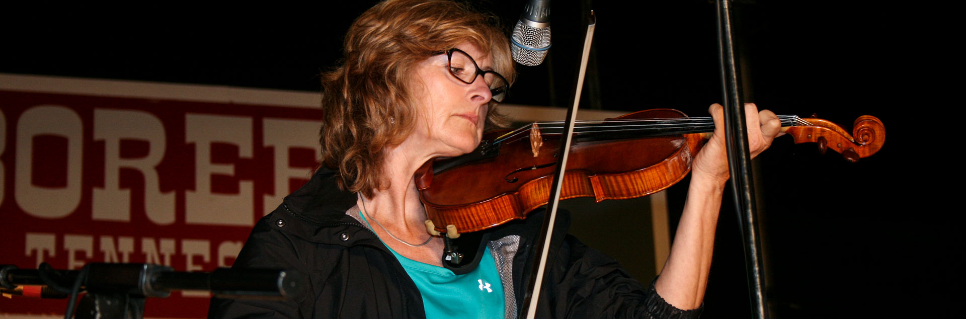 Women playing fiddle